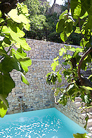 The cool waters of a courtyard bassin are enclosed by a series of stone terraces