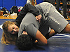 Claudia Zieba, Copiague High School junior, works on taketown techniques with senior Kory Corkins during wrestling practice at Cpiague High School on Tuesday, Jan. 31, 2017.