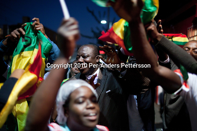 JOHANNESBURG, SOUTH AFRICA - JUNE 13: Immigrants from Ghana celebrate in the streets as their team beat Serbia 1-0 on June 13, 2010, in central Yeoville, and immigrant suburb in Johannesburg, South Africa. South Africa has a big amount of people from Ghana residing here. Ghana is the only African team that advance from the group stages in the 2010 World Cup. In hosting the largest sporting event in the world, South Africa has a chance to impress the world with their country, hoping that the month long event will bring long lasting benefits for the country. (Photo by Per-Anders Pettersson)