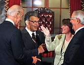 Washington, DC - July 7, 2009 -- United States Senator Al Franken (Democrat of Minnesota), left center, shares a light moment with Vice President Joseph Biden, left, U.S. Senator Amy Klobuchar (Democrat of Minnesota), right center, and former Vice President Walter Mondale, right, after posing for a group photo following the mock swearing-in ceremony in the Old Senate Chamber in the U.S. Capitol in Washington, D.C. on Tuesday, July 7, 2009.  .Credit: Ron Sachs / CNP