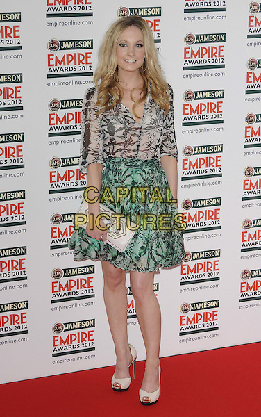 Joanne Froggatt.The Jameson Empire Film Awards 2012, Grosvenor House Hotel, Park Lane, London, England..March 25th, 2012.full length green grey gray black print skirt top dress clutch bag white .CAP/CAN.©Can Nguyen/Capital Pictures.