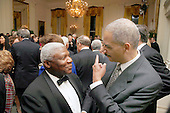 Washington, DC - March 4, 2009 -- United States Attorney General Eric Holder, right, talks with the White House usher at a dinner for Congressional  Committee chairmen and ranking members in the East Room of the White House on Wednesday, March 4, 2009. .Credit: Dennis Brack - Pool via CNP
