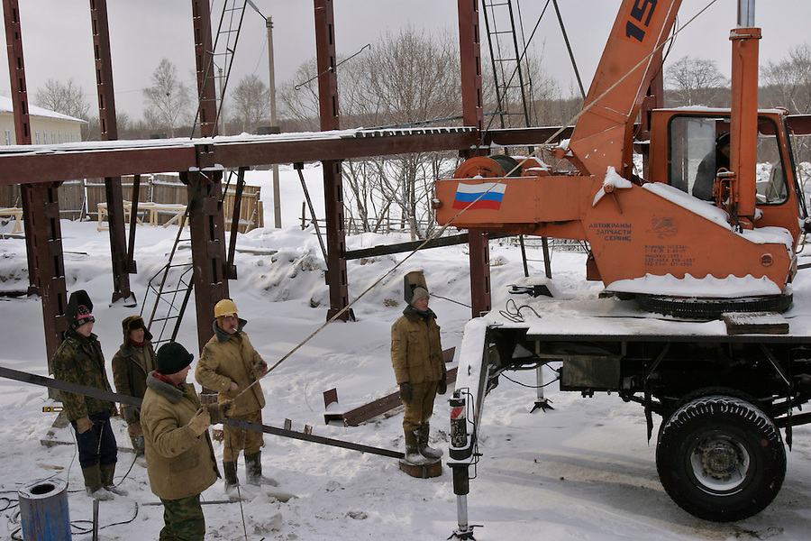Sikachi-Alyan, Russia, 29/02/2004.&amp;#xD;Construction work on a new village club-house.<br />