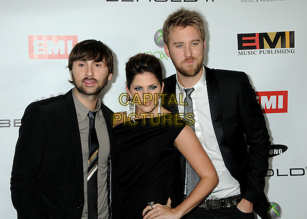 LADY ANTEBELLUM - Dave Haywood, Hillary Scott & Charles Kelley .EMI Post Grammy Party 2010 held at the W Hollywood Hotel, Hollywood, California, USA, 31st January 2010..half length black one shoulder  dangly earring silver tie beard facial hair hand on hip dress suit grammys .CAP/ADM/BP.©Byron Purvis/Admedia/Capital Pictures