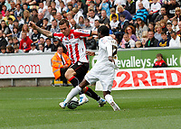 Npower Championship, Swansea City FC (white) V Sheffield United. Sat 7th May 2011 (12.45pm KO)<br /> Pictured: Nathan Dyer of Swansea takes on sheff utd defender Joe Mattock<br /> Picture by: Ben Wyeth / Athena Picture Agency<br /> info@athena-pictures.com<br /> 07815 441513