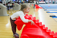 NWA Democrat-Gazette/CHARLIE KAIJO Molly Bishop, 3, of Bentonville, watches her bowling ball, Sunday, February 11, 2018 at the Rogers Bowling Center in Rogers. Low temperatures left many of the roads icey. <br />
