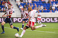 Thierry Henry (14) of the New York Red Bulls takes a shot during the first half against CD Chivas USA during a Major League Soccer (MLS) match at Red Bull Arena in Harrison, NJ, on May 23, 2012.
