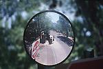 WOMEN ON STREET REFLECTED IN MIRROR