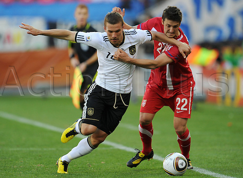 Lukas Podolski (L) of Germany vies with Zdravko Kuzmanovic of Serbia during the FIFA World Cup 2010 group D match between Germany and Serbia at the Nelson Mandela Bay Stadium in Port Elizabeth, South Africa 18 June 2010.