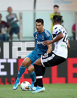 Calcio, Serie A: Parma - Juventus, Parma stadio Ennio Tardini, 24 agosto 2019. i<br /> Juventus' Cristiano Ronaldo (l) in action with Parma's Bruno Alves (r) during the Italian Serie A football match between Parma and Juventus at Parma's Ennio Tardini stadium, August 24, 2019. <br /> UPDATE IMAGES PRESS/Isabella Bonotto