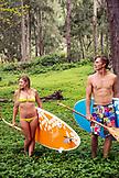 USA, Hawaii, The Big Island, paddle boarders in the lush Waipio Valley