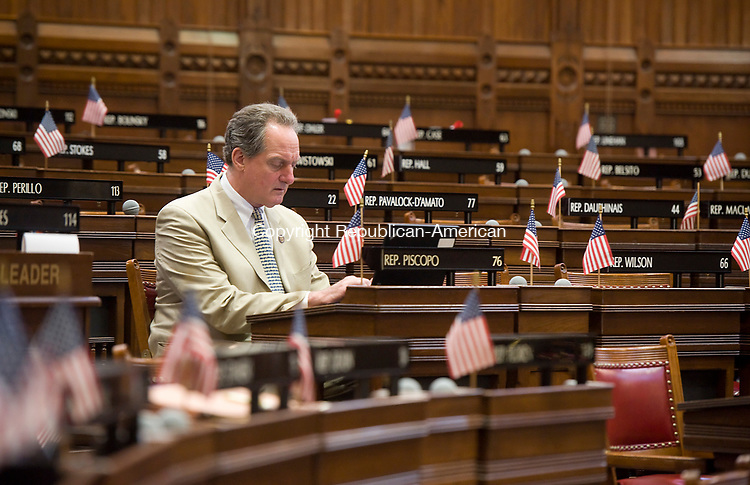HARTFORD, CT-062917JS10- State Rep. John Piscopo (R-76), works at his seat inside chambers Thursday at the State Capitol in Hartford.  Jim Shannon Republican-American