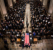 The Honor Guard carries the casket of former president George Herbert Walker Bush down the center isle following a memorial ceremony at the National Cathedral in Washington, Wednesday,  Dec.. 5, 2018.  <br /> Credit: Doug Mills / Pool via CNP