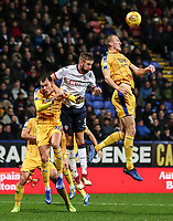 Bolton Wanderers' Mark Beevers competing with Wigan Athletic's Dan Burn<br /> <br /> Photographer Andrew Kearns/CameraSport<br /> <br /> The EFL Sky Bet Championship - Bolton Wanderers v Wigan Athletic - Saturday 1st December 2018 - University of Bolton Stadium - Bolton<br /> <br /> World Copyright © 2018 CameraSport. All rights reserved. 43 Linden Ave. Countesthorpe. Leicester. England. LE8 5PG - Tel: +44 (0) 116 277 4147 - admin@camerasport.com - www.camerasport.com