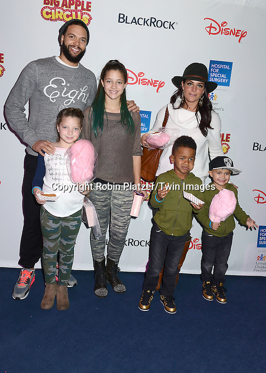 Deron Williams and his family attend the Hospital for Special Surgery's 8th Annual  Big Apple Circus Benefit on December 6, 2014 at Damrosch Park in Lincoln Center  in New York City, USA.<br /> <br /> photo by Robin Platzer/Twin Images<br />  <br /> phone number 212-935-0770