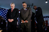Tulsa, Oklahoma.USA.January 30, 2004..Presidential hopeful General Wesley Clark prays at a rally held at the Mount Zion Baptist Church.