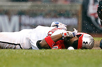 Outfielder Byron Buxton #11 of Appling County High School in Baxley, Georgia lays on the ground next to the ball that hit him in the upper back during the Under Armour All-American Game at Wrigley Field on August 13, 2011 in Chicago, Illinois.  After Buxton was hit by the pitch the umpires called the game due to heavy rain causing insufficient playing conditions.  (Mike Janes/Four Seam Images)