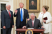 US President Donald J. Trump (2-L) reacts after Rex Tillerson (2-R) signed an appointment affidavit after being sworn-in as US Secretary of State by US Vice President Mike Pence (L), as Tillerson's wife Renda St. Clair (R) looks on; in the Oval Office of the White House in Washington, DC, USA, 01 February 2017. Tillerson was confirmed by the Senate, 01 February, in a 56-to-43 vote to become the nation's 69th Secretary of State.<br /> Credit: Michael Reynolds / Pool via CNP