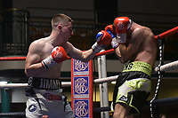 Jay Smith (white shorts) defeats Dean Evans during a Boxing Show at York Hall on 30th November 2018