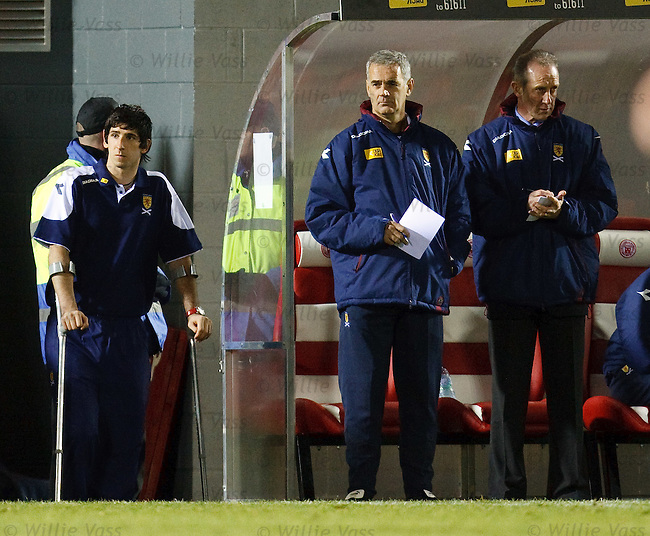Injured goalkeeper Alan Martin watches on his crutches during the second half