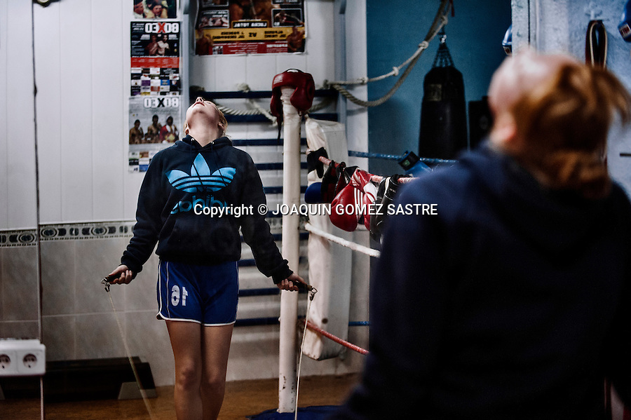 Maria a young boxer during his training at the Martinez Boxing Club