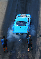 Jun 17, 2016; Bristol, TN, USA; Crew members with NHRA pro mod driver Michael Biehle during qualifying for the Thunder Valley Nationals at Bristol Dragway. Mandatory Credit: Mark J. Rebilas-USA TODAY Sports