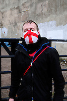 English Defence League (EDL) demonstration<br /> called in protest to the proposed building of a new mosque in Dudley.<br /> A supporter of the English Defence League wearing an English flag mask.