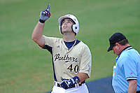 18 March 2012:  FIU infielder Mike Martinez (40) breaks Tyler Townsend's career RBI record with his first home run of the season in the sixth inning as the Florida Atlantic University Owls defeated the FIU Golden Panthers, 9-3, at University Park in Miami, Florida.