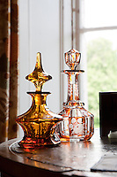 Engraved glass decanters in the twin bedroom