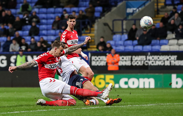 Bolton Wanderers' Josh Magennis slides in to make a shot at goal<br /> <br /> Photographer Andrew Kearns/CameraSport<br /> <br /> The EFL Sky Bet Championship - Bolton Wanderers v Middlesbrough -Tuesday 9th April 2019 - University of Bolton Stadium - Bolton<br /> <br /> World Copyright © 2019 CameraSport. All rights reserved. 43 Linden Ave. Countesthorpe. Leicester. England. LE8 5PG - Tel: +44 (0) 116 277 4147 - admin@camerasport.com - www.camerasport.com