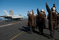 120522-N-DR144-801 .PACIFIC OCEAN (May 21, 2012) Plane captains assigned to Strike Fighter Squadron (VFA) 22 bid farewell to a launching F/A-18F Super Hornet as pilots and aircraft assigned to Carrier Air Wing (CVW) 17 depart the flight deck of the Nimitz-class aircraft carrier USS Carl Vinson (CVN 70) and return to their home bases after nearly six months embarked. Carl Vinson and CVW 17 recently completed a deployment to the U.S. 5th and 7th Fleet areas of operations. (U.S. Navy photo by Mass Communication Specialist 2nd Class James R. Evans/Released).