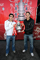 Pictured L-R: Swansea City FC players Jordi Gomez and Andrea Orlandi with the FA Cup at the Liberty Stadium, Swansea, south Wales. Friday 06 February 2009<br />