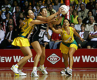 16.11.2007 Silevr Ferns Irene Van Dyk competes with Australia's Liz Elliz and Mo'onia Gerrard during the Silver Ferns v Australia Final at the New World Netball World Champs held at Trusts Stadium Auckland New Zealand. Mandatory Photo Credit ©Michael Bradley.