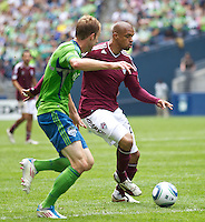Colorado Rapids forward Caleb Folan, right, challenges Seattle Sounders FC defender Tyson Wahl during play at CenturyLink Field in Seattle Saturday July 17, 2011. The Sounders won the game 4-3.
