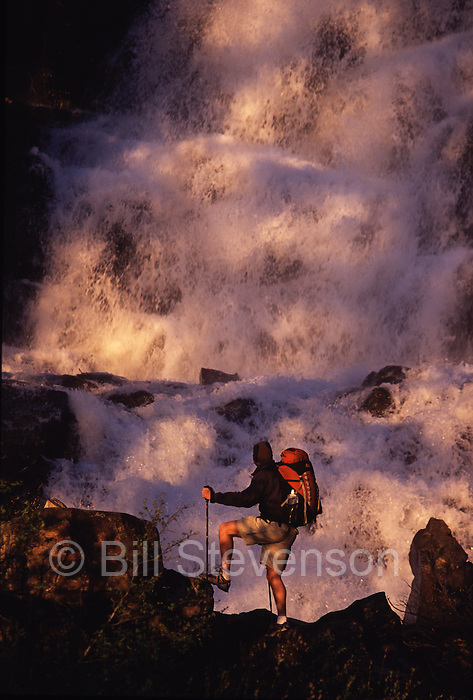 A man hiking in front of a waterfall , Eagle Falls, at Lake Tahoe in California.