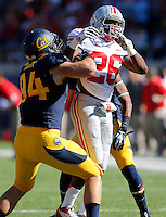 Ohio State Buckeyes cornerback Armani Reeves (26) fights through the block by California Golden Bears wide receiver Jacob Wark (84) during the first quarter of NCAA football game at Memorial Stadium in Berkeley, California on Sept. 14, 2013. (Adam Cairns / The Columbus Dispatch)