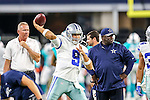 Dallas Cowboys quarterback Tony Romo (9) in action during the pre-season game between the Miami Dolphins and the Dallas Cowboys at the AT & T stadium in Arlington, Texas.