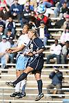 24 November 2007: North Carolina's Casey Nogueira (54) and Notre Dame's Julie Scheidler (25). The University of Notre Dame Fighting Irish defeated University of North Carolina Tar Heels 3-2 at Fetzer Field in Chapel Hill, North Carolina in a Third Round NCAA Division I Womens Soccer Tournament game.