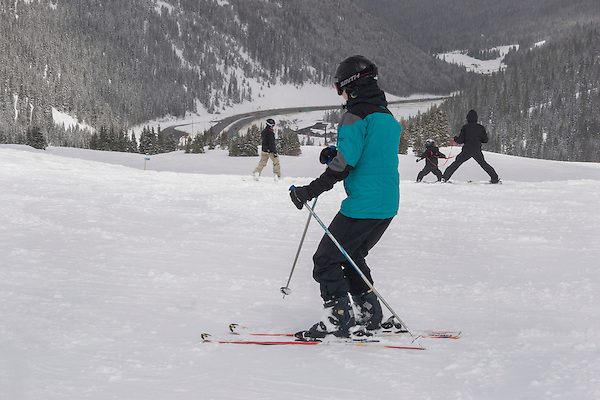 Family teaching child to ski at Loveland Ski Area, Colorado, .  John leads private ski trips to Front Range and Summit County Ski Areas in Colorado.