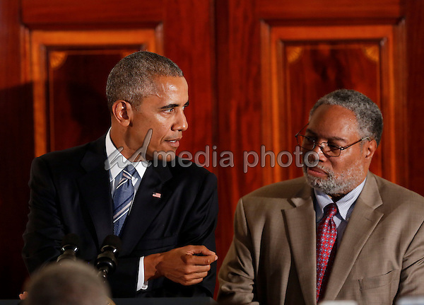 US President Barack Obama delivers remarks, while Lonnie Bunch, the director of the Smithsonian National Museum of African American History and Culture listens,  at the reception in honor of the opening of the museum in the Grand Foyer of the White House September 22, 2016, Washington, DC. Photo Credit: Aude Guerrucci/CNP/AdMedia