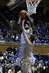 31 December 2014: Duke's Amile Jefferson (21) shoots over Wofford's Lee Skinner (34). The Duke University Blue Devils hosted the Wofford College Terriers at Cameron Indoor Stadium in Durham, North Carolina in a 2014-16 NCAA Men's Basketball Division I game.