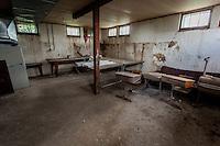 Old desks inside abandoned school in Boyes, MT