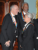 Washington, DC - December 6, 2008 -- Pete Townshend, left, and Twyla Tharp, right, share a conversation prior to posing for the formal group photo following the Artist's Dinner at the United States Department of State in Washington, D.C. on Saturday, December 6, 2008 to honor 2008 recipients of the Kennedy Center Honors.  Morgan Freeman smiles at top center.Credit: Ron Sachs - Pool via CNP