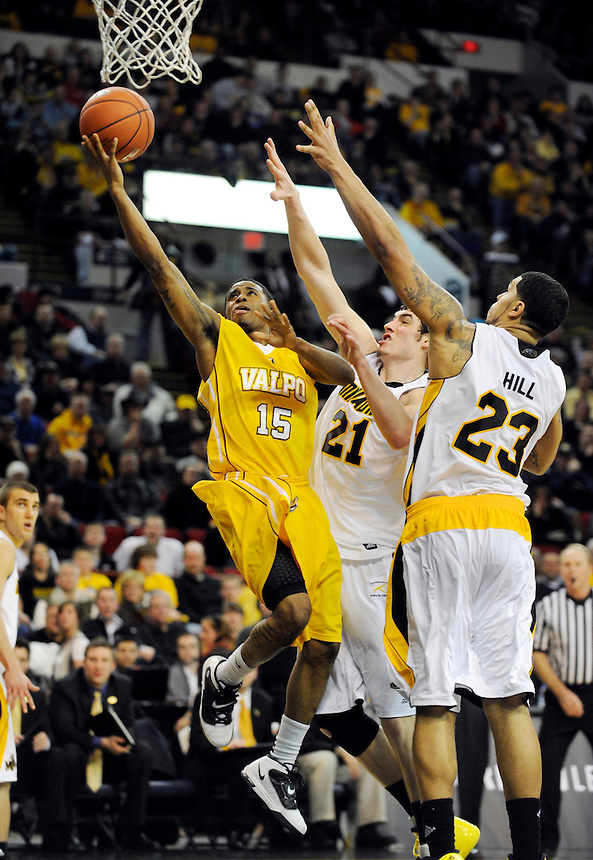 Valparaiso's Erik Buggs is pressured by the University of Wisconsin Milwaukee's Tony Meier (21) and Anthony Hill during the second half of the Horizon League semifinal championship game in Milwaukee, Wisconsin on Saturday, March 5, 2011. | Ernie Mastroianni~For Sun-Times Media