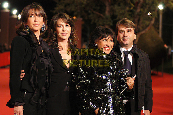"LEONE FAMILY.(from sx to dx Raffaella Francesca Carla and Andrea).Introducing the world premiere of the restored version of ""Once Upon a Time in the West"" at the 2nd annual Rome Film Festival, Rome, Italy..October 24th, 2007.half length black suit coat jacket .CAP/CAV.©Luca Cavallari/Capital Pictures."