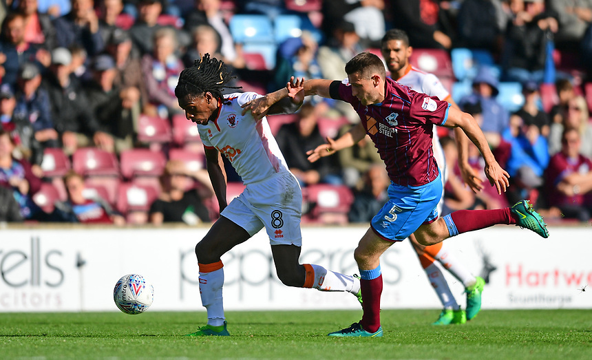 Blackpool's Sessi D'Almeida is fouled by Scunthorpe United's Murray Wallace<br /> <br /> Photographer Chris Vaughan/CameraSport<br /> <br /> The EFL Sky Bet League One - Scunthorpe United v Blackpool - Saturday 9th September 2017 - Glanford Park - Scunthorpe<br /> <br /> World Copyright &copy; 2017 CameraSport. All rights reserved. 43 Linden Ave. Countesthorpe. Leicester. England. LE8 5PG - Tel: +44 (0) 116 277 4147 - admin@camerasport.com - www.camerasport.com