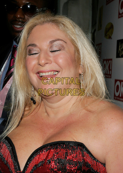 VANESSA FELTZ.At the OK! Magazine Christmas Party, .Jewel, Piccadilly, London, England,.December 5th 2006..portrait headshot black and red lace top strapless eyes shut funny face.CAP/AH.©Adam Houghton/Capital Pictures.