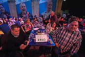 02.01.2015.  London, England.  William Hill PDC World Darts Championship.  Quarter Final Round.  BDO Players Robbie Green [R] and Alan Norris watch the action at the 2015 William Hill World Darts Championship.