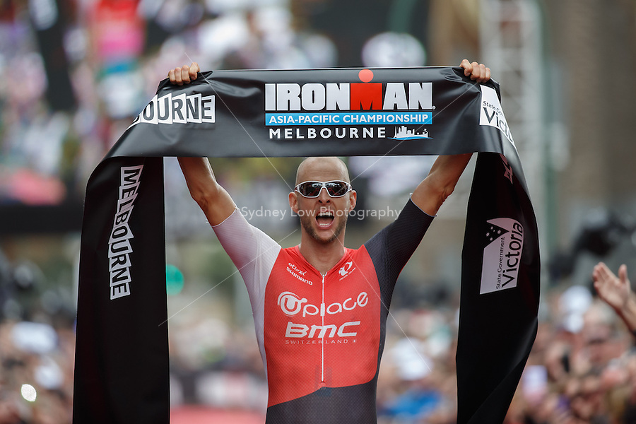 Dirk BOCKEL (LUX) celebrates after winning the IRONMAN Asia-Pacific Championship in Melbourne, Australia on Sunday March 23, 2013. (Photo Sydney Low / sydlow.com)