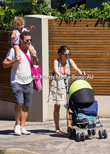30 DECEMBER 2015 SYDNEY AUSTRALIA<br /> <br /> EXCLUSIVE PICTURES<br /> <br /> Tammin Sursock pictured enjoying a day at the beach with her family - husband Sean McEwan and daughter Pheonix - while on holidays back in Australia. Tammin wore a modest neoprene bikini and a wide brimmed hat as she waded waist deep in the cool waters of a northern beach.